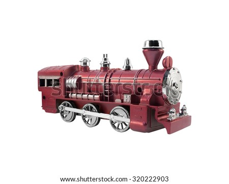 Isolated toy train angle view. Isolated old fashioned red toy train angle view with metal elements. - stock photo