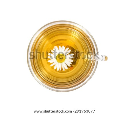 isolated transparent cup of tea with camomile flower. View from above. - stock photo
