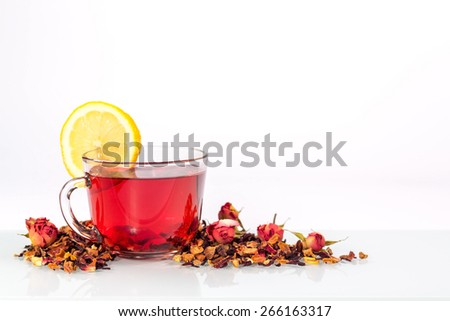 isolated transparent mug of flower tea with lemon and rose - stock photo