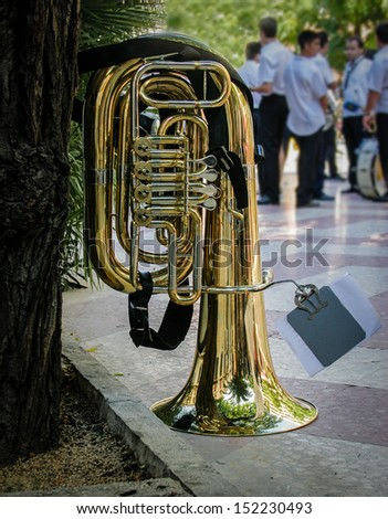 Isolated tuba in a park - stock photo