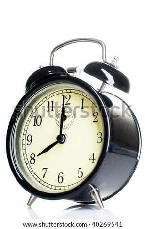 Isolated vintage alarm-clock - stock photo
