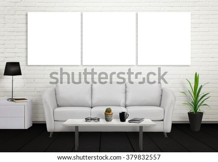 Isolated wall art canvas on gray wall. Sofa, lamp, plant, glasses, book, coffee on table in room interior.  - stock photo