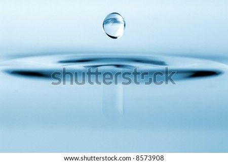 isolated water drop with rippling water - stock photo