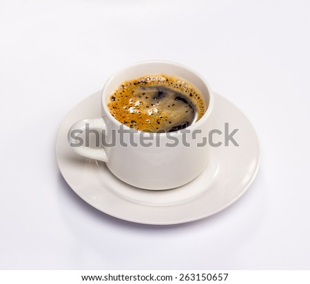 isolated white saucer and cup of black coffee with foam - stock photo