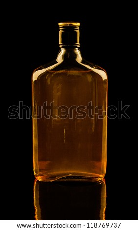 Isolated with clipping paths single bottle of whisky with reflection. Warm colors image - stock photo