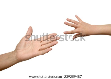 Isolated woman and child hands reach toward each other - stock photo