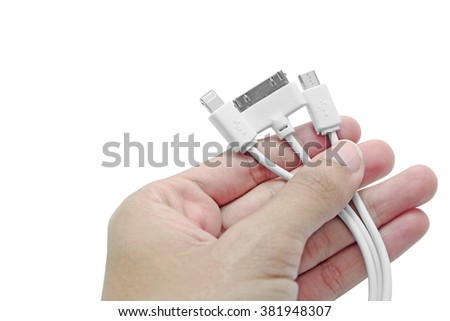 Isolated Woman hand holds several smart phone chargers - stock photo