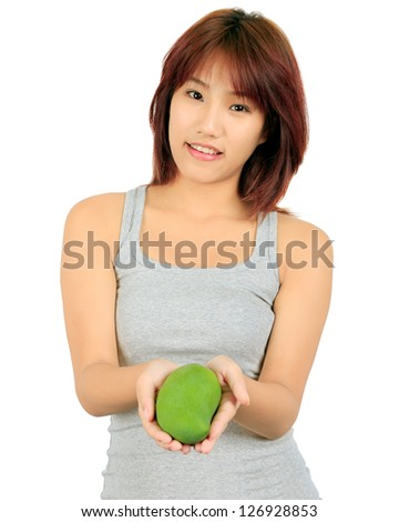 Isolated young asian woman with a mango over white. - stock photo