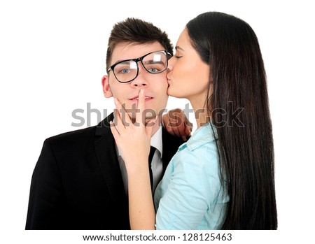 Isolated young business couple kissing - stock photo