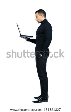 Isolated young business man with notebook - stock photo