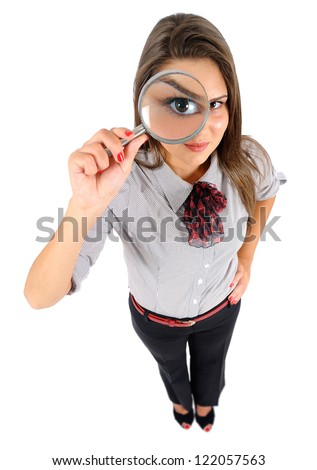 Isolated young business woman magnifying - stock photo