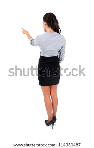 Isolated young business woman pointing back - stock photo