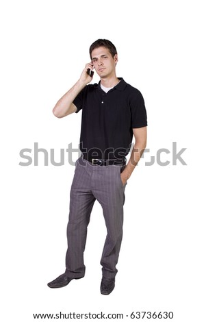 Isolated Young businessman conversing on cell phone - stock photo