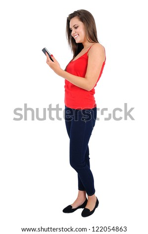 Isolated young casual girl using phone - stock photo
