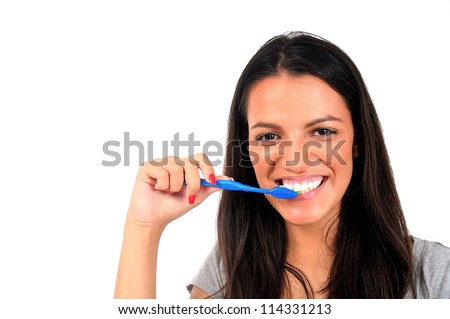 Isolated young casual woman cleaning teeth - stock photo