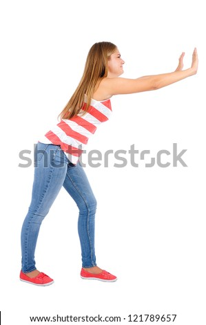 Isolated young casual woman push something - stock photo