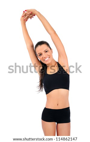 Isolated young fitness woman stretching - stock photo
