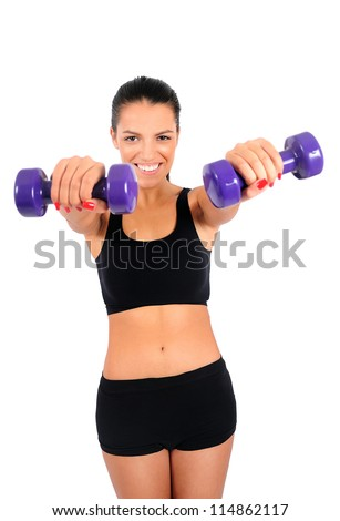 Isolated young fitness woman with dumbbell - stock photo