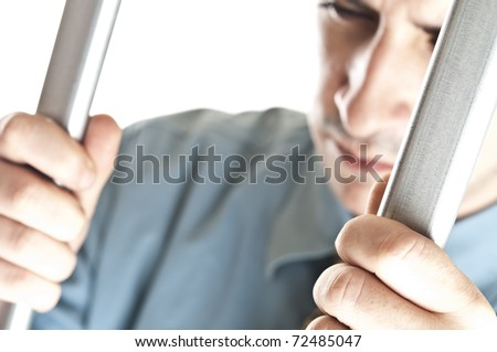 Isolated young man in jail - stock photo