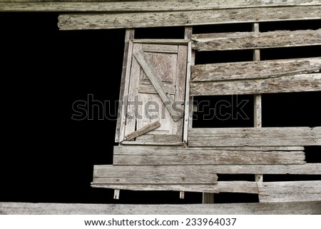Isolates gap wooden walls and windows of old houses decayed. - stock photo