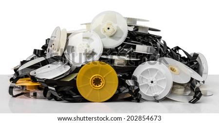 Isolates of VHS tape is not used to bring together a pile of clutter. - stock photo