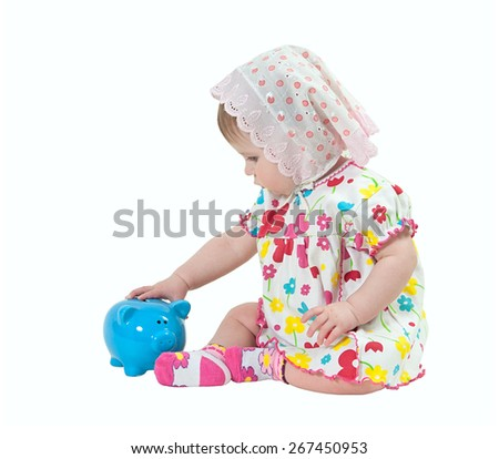isolation image of a child with piggy bank - stock photo