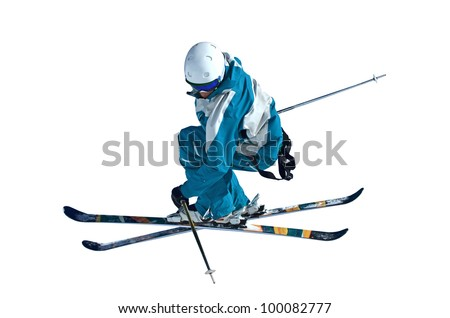 Isolation of a  ski jumper in mid air looks down at the ground way below. - stock photo