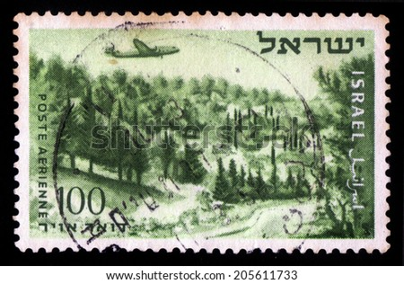 ISRAEL - CIRCA 1954: a airmail stamp printed in Israel, shows plane over Shaar Hagai on the way to Jerusalem, circa 1954 - stock photo
