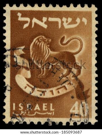 ISRAEL - CIRCA 1956: A stamp printed in Israel honoring twelve tribes of Israel shows Judah - lions whelp, series emblems of the twelve tribes of Israel, circa 1956 - stock photo
