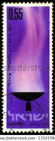 ISRAEL - CIRCA 1970: A stamp printed in Israel, shows memorial flame , devoted to  memorial day for the fallen of Israel's defence army, circa 1970 - stock photo