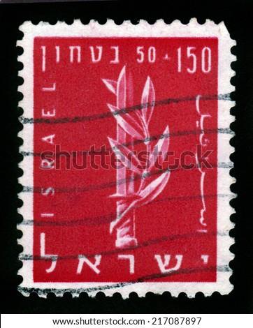 ISRAEL - CIRCA 1957: A stamp printed in Israel shows the emblem of the Haganah, Jewish paramilitary organization, series Security of Israel, circa 1957 - stock photo