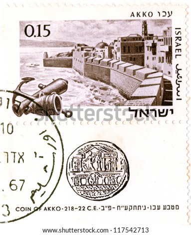"""ISRAEL - CIRCA 1967: An old used Israeli postage stamp of the series """"Ancients Ports of Israel"""", showing view of Acre and ancient coin of Acre; series, circa 1967 - stock photo"""