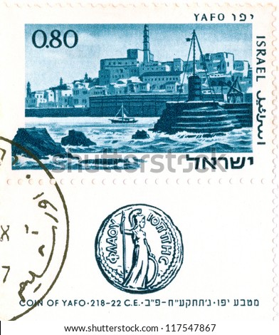 """ISRAEL - CIRCA 1967: An old used Israeli postage stamp of the series """"Ancients Ports of Israel"""", showing view of Jaffa and ancient coin of Jaffa; series, circa 1967 - stock photo"""