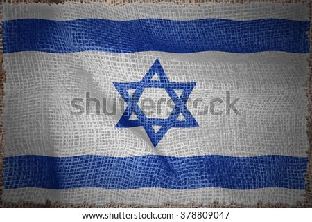 Israel flag on sackcloth textured background - stock photo