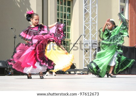 """ISTANBUL - APRIL 23: Unidentified 8 years old Colombian children in traditional costume perform folk dance during """"National Sovereignty and Children Day"""" festival, April 23, 2010 in Istanbul. - stock photo"""