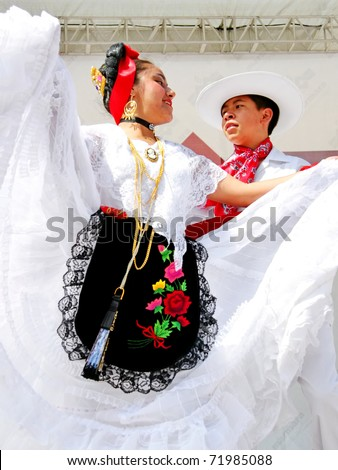 """ISTANBUL - APRIL 23: Unidentified 12 years old Mexican children in traditional costume perform folk dance on """"National Sovereignty and Children Day"""" festival, April 23, 2010 in Istanbul, Turkey - stock photo"""
