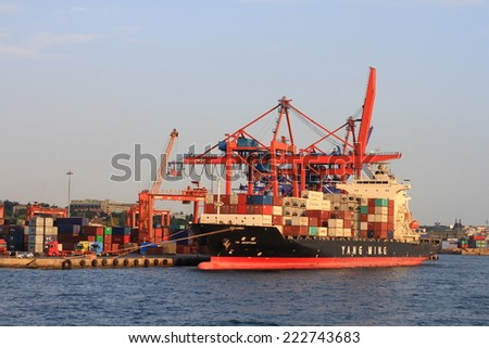 ISTANBUL - AUG 27, 2012: YANG MINGs cargo ship, INCEPTION (IMO: 9319155, Liberia) full of containers in port Haydarpasa. A 172x27 mt vessel launched into the sea in 2006 and has a 22027 DWT.  - stock photo