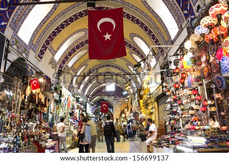ISTANBUL, August 31: People shopping in the Grand Bazar in Istanbul, Turkey, one of the largest covered markets in the world, Istanbul, August 31, 2013  - stock photo