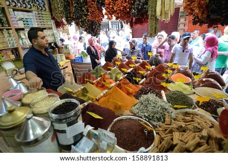 ISTANBUL - AUGUST 9: Unknown man trades spices in an Egyptian Bazaar, August 9, 2013 in Istanbul, Turkey. Egyptian Bazaar (Spice Market) one of the most popular tourist attractions in Istanbul - stock photo