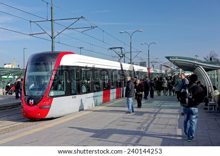 ISTANBUL - DECEMBER 20: A modern tram on Sirkeci on December 20, 2014 in Istanbul. Due to increasing traffic & air pollution, Istanbul became one of most polluted city also planned for return of tram. - stock photo