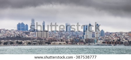 Istanbul European side skyline, view from Bosporus strait in foggy day. Panoramic montage from 2 images - stock photo