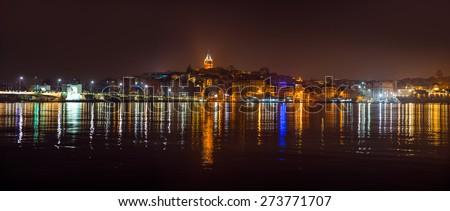 Istanbul, Galata tower and bridge at night - stock photo