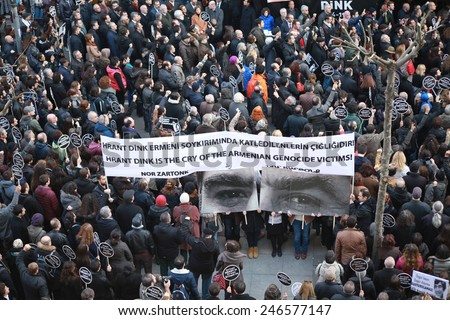 ISTANBUL - JANUARY 19: Mourners gather to commemorate Hrant Dink on the anniversary of his death in front of his newspepar Agos on 19 January 2015 in Istanbul,Turkey. - stock photo