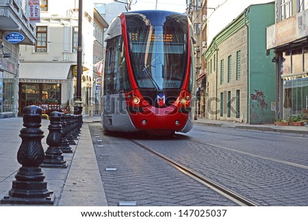 ISTANBUL - JULY 15 A modern tram on  on July 15, 2013 in Istanbul. Due to increasing traffic & air pollution, Istanbul became one of most polluted city also planned for return of tram.  - stock photo