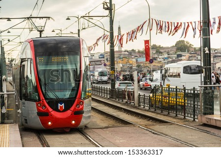 ISTANBUL - JULY 25 A modern tram on on July 25, 2013 in Istanbul. Due to increasing traffic & air pollution, Istanbul became one of most polluted city also planned for return of tram. - stock photo