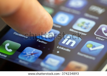 ISTANBUL - JULY 06, 2012: Apple Iphone 4S screen with a male finger starting Twitter app for social messaging. - stock photo