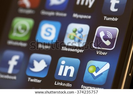 ISTANBUL - JULY 06, 2012: Apple Iphone 4S screen with social media applications of Google Plus, Google Voice, Tumblr, Facebook, Twitter, Skype, Linkedin, Whatsapp and Messenger. - stock photo