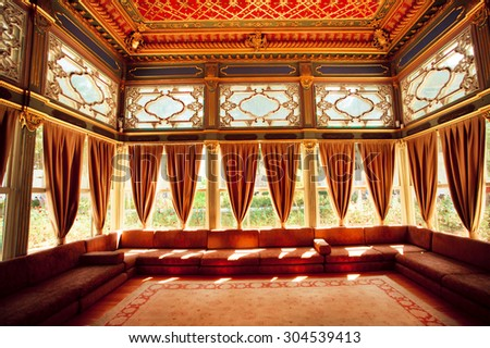 ISTANBUL - JULY 22: Curtains, Turkish sofas and colorful ceiling in traditional Ottoman room of  the 15th century Topkapi Palace on July 22, 2015 in Turkey. Istanbul is the 5th largest city in world - stock photo