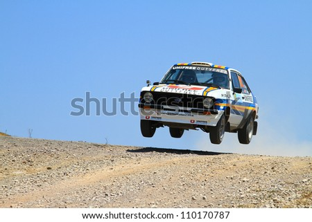 ISTANBUL - JULY 07: Engin Kap drives a Ford Escort Mk2 car during 41st Bosphorus Rally ERC Championship, Halli Stage on July 7, 2012 in Istanbul, Turkey. - stock photo