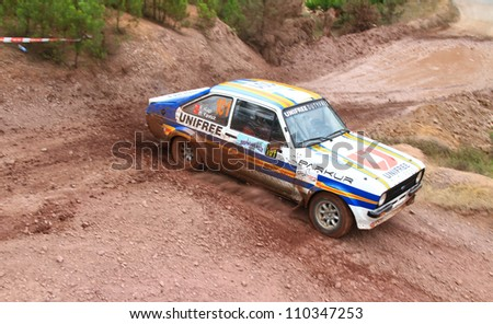 ISTANBUL - JULY 08: Engin Kap drives a Ford Escort Mk2 car during 41st Bosphorus Rally ERC Championship, Halli Stage on July 8, 2012 in Istanbul, Turkey. - stock photo